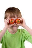 Boy with tomatoes around the eyes Stock Photography