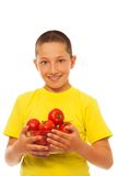 Boy and tomatoes Stock Image