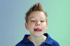 Boy with tongue out Royalty Free Stock Photos