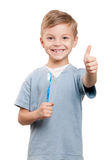 Boy with tooth brush. Portrait of a little boy holding a tooth brush over white background royalty free stock photography