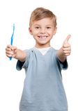 Boy with tooth brush Royalty Free Stock Images