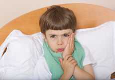 Boy with a tooth pain. Boy of six years has tooth pain stock image
