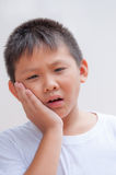 Boy with a toothache Stock Photos