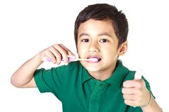 Boy and toothbrush Stock Image