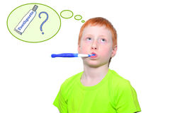 Boy and a toothbrush. Funny boy in a green tshirt violently brushing his teeth royalty free stock image