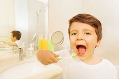 Boy with toothbrush and mouth wide opened Stock Photography