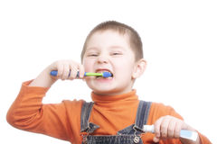 Boy with toothpaste and brush Royalty Free Stock Photography