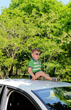 Boy on top of car Royalty Free Stock Photography