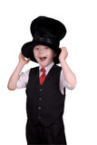 Boy in top hat. Boy with Funny expression wearing a floppy top hat isolated over white Stock Photos