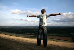Boy on the top of hill. Teenager boy standing on top Box Hill, England Royalty Free Stock Photos