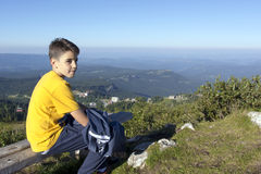 Boy on the top of the mountain stock image