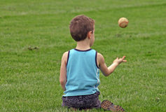 Boy Tossing Baseball Royalty Free Stock Photo