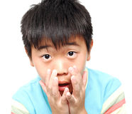 Boy touch his face Royalty Free Stock Photography