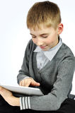 Boy with touch pad Stock Photo