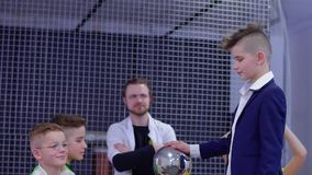 Boy touch to van de graaff generator exploring electrostatic voltage on himself. Children and laboratory assistant make physical experiment with Van de Graaff stock video footage