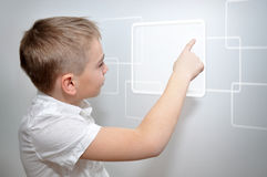 Boy touching frame. Young boy touching virtual frame Royalty Free Stock Images