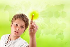 Boy touching futuristic green interface. Stock Photos