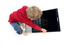 Boy touching laptop computer Royalty Free Stock Photos