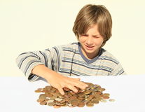 Boy touching money Stock Photo