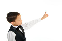 Boy touching something with his finger isolated Stock Image