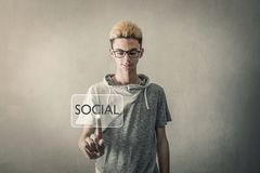 Boy touching virtual screen social key Royalty Free Stock Images