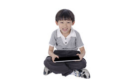 Boy with a touchpad Stock Photography