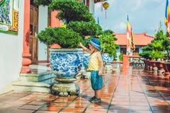 Boy tourist in Buddhist temple in Vietnam Nha Trang Stock Photo