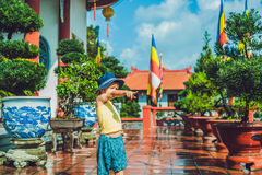 Boy tourist in Buddhist temple in Vietnam Nha Trang Stock Photo