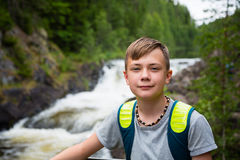 Boy tourist standing near the mountain waterfall Stock Photography