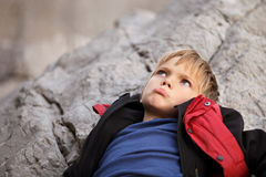 Boy tourist upset and resting after a hike Royalty Free Stock Image