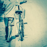 Boy tow bicycle back to home. Stock Photography