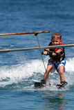 Boy towed on waterskis royalty free stock photo