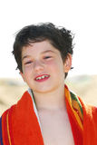 Boy in a towel royalty free stock photography