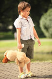 Boy with toy. Offended little boy with toy in park Stock Images