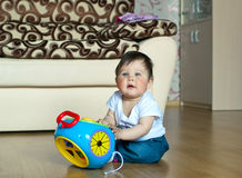 Boy with toy. The little boy with toy at home. Shallow DOF Royalty Free Stock Images