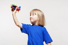 Boy with toy airplane Stock Photography
