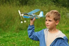 Boy with toy airplane in hands Stock Photo