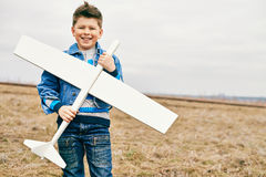 Boy with toy airplane Stock Image