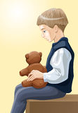 Boy with toy bear. Calm boy with toy bear in his hands is thinking deeply he sims to be a little bit unhappy so the theme of charity may be quite near Royalty Free Stock Photography