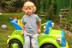 Boy with toy car. Boystaying near big toy car Stock Photos