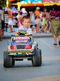 Boy in the toy car Royalty Free Stock Photography