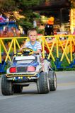 Boy in the toy car Royalty Free Stock Image