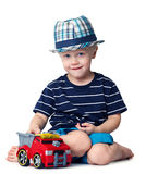 Boy with a toy car. Little boy with a toy car isolated on white Stock Image
