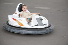 Boy on toy car Royalty Free Stock Photography