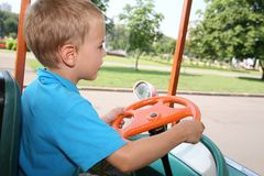 Boy in toy car Royalty Free Stock Image