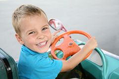 Boy in toy car Stock Photos