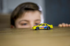 Boy with toy car Royalty Free Stock Photography