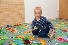 Boy and toy cars. Royalty Free Stock Photo