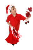 Boy with toy Christmas sack Stock Images
