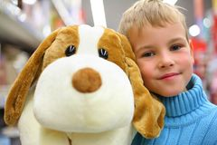 Boy with toy dog in shop Royalty Free Stock Photo